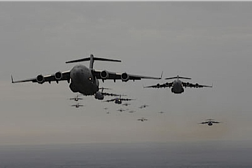 C-17 a formation of them Flying over Bagdhad.