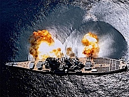 """USS IOWA FIRES HER MASSIVE 16"""" GUNS IN A MASSIVE BROADSIDE. NOTICE THE CONCUSSION ON THE WATER."""