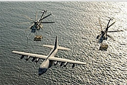 KC-130. 2,Helicopters fueling at the same time of her.