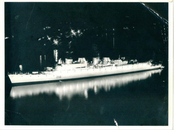 HERE WE SEE HMS ANTRIM, IN GRAND HARBOUR AT NIGHT, FLOODLIT FOR SOME OCCASION
